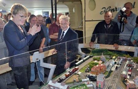 Eddie Izard viewing the model railway